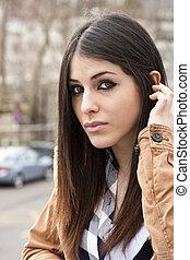 latina brunette girl outside