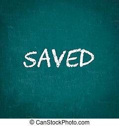 SAVED written on chalkboard