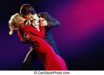 Elegant couple in the dance of love - Elegant young couple...
