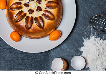 cake on plate with ingredients flour, eggs