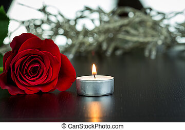 Red Rose and Small Candle on Table