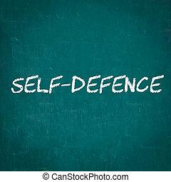 SELF-DEFENCE written on chalkboard