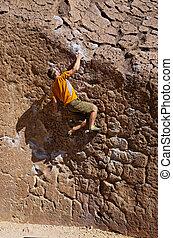 Man Bouldering - a man bouldering on the volcanic tablelands...