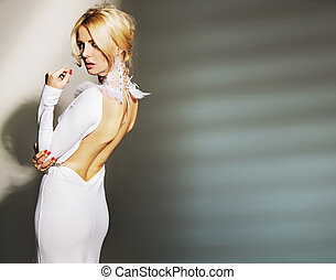 Stunning young woman wearing white gown - Stunning young...