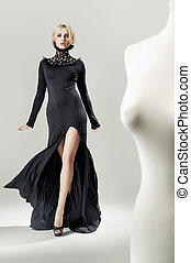 Shapely, alluring blond lady in black gown - Shapely,...