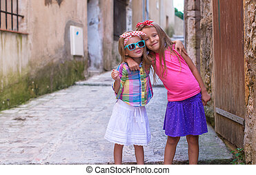 Adorable little girls outdoors in European city - Adorable...