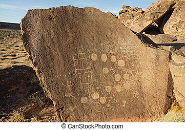 Petroglyphs - petroglyphs carved into volcanic tuff rock on...