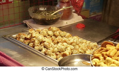 Dumplings grilling at vendor in Lehua Night Market in the...
