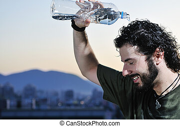 man water - young man drinking fresh water from bottle...