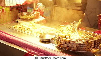 Dumplings grilling at vendor in Lehua Night Market in the...