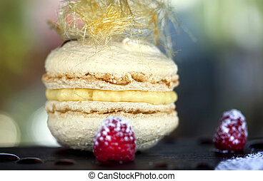 Macxaroon - Macaroon with vanilla cream and raspberries in a...