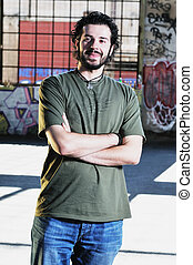 urban fashion - happy young man posing outdoor in urban...