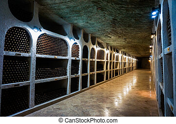 Bottles of high quality wine in the traditional wine cellar
