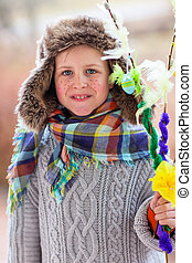 Easter Finnish traditions - Cute little boy outdoors dressed...