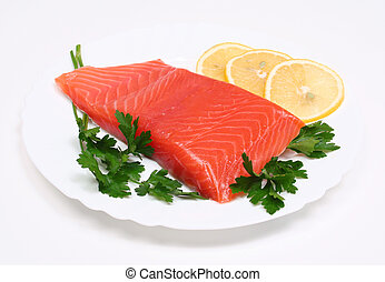 Salmon steak with lemon slices and parsley