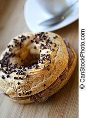 French cake - Paris-Brest cake with chocolate mousse on a...