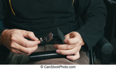 Male Hands Take Glasses out of the Case and Wear Them,...