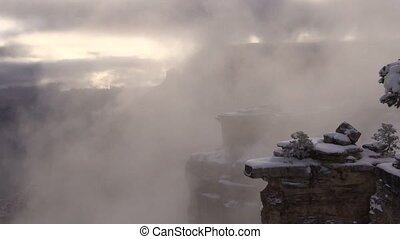 Grand Canyon in Winter - a fog shrouded morning in a snow...