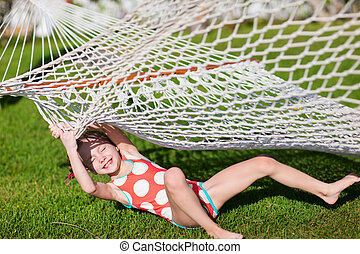 Adorable little girl in hammock - Adorable little girl...