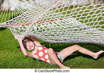 Adorable little girl in hammock - Adorable little girl...
