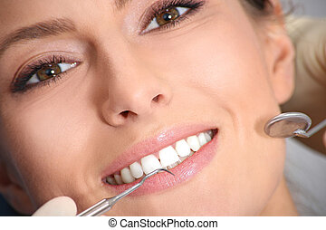 examination of the teeth in the office of the dentist -...