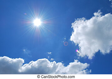 Bright sun with blue skies and clouds