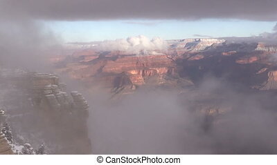 Grand Canyon Winter Landscape - a fog shrouded winter...