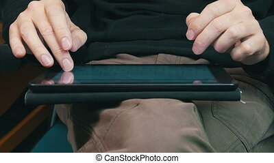 Male Hands Typing on a Tablet