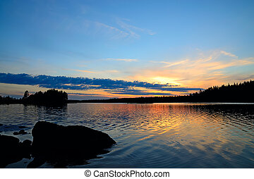 Romantic sunset. North Karelia, Russia - Evening rest. Lake...