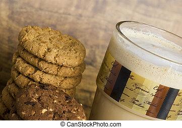 Latte macchiato - milk coffee in glas and cookies