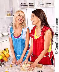 Girl baking cookies in the oven