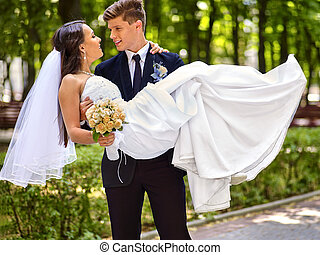 Bride and groom with flower outdoor. - Bride and groom with...