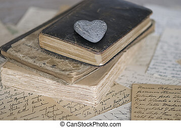 old books - close up of old books with stone hearts