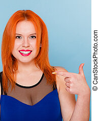 Happy woman giving thumbs up sign isolated - Happy red hair...