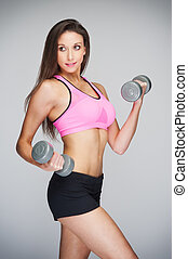 Fit Woman Lifting Weights - Studio shot of fitness training...