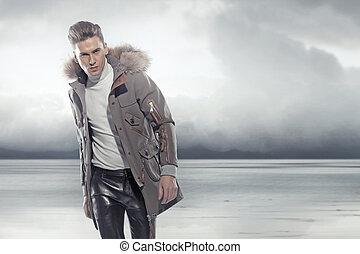 Elegant man walking in the winter