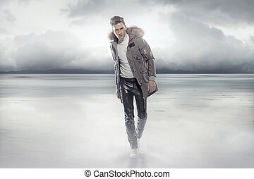 Elegant man walking on the frozen lake