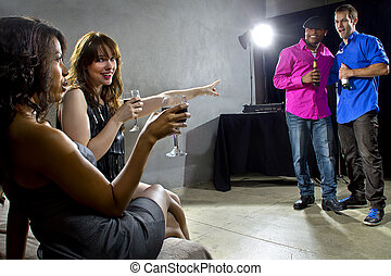 Socializing at Nightclub - mixed crowd drinking and...