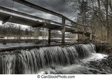 Wooden Walking Bridge Over Winter Waterfall - An old wooden...