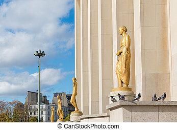 gold sculptures - statue of women in front of the cite de...