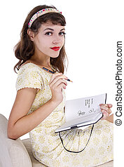 Diary - young female writing on a retro style diary with...