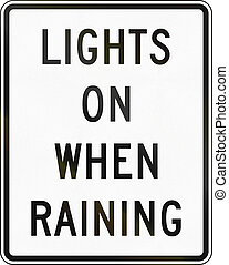 Lights On When Raining - United States traffic sign: Lights...