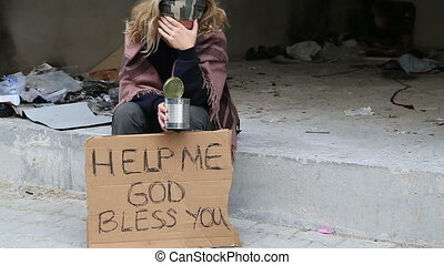 Homeless woman begging