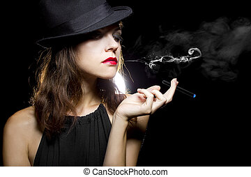 Woman with Thin Electronic Cigarette - female vaping an...