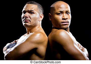 Boxing Rivals - black boxer posing with latino opponent on a...