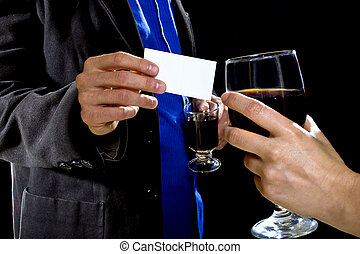 Handing a Businesscard at a Bar - businessman handing over...