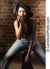 sitting and smoking cigar - beautiful asian girl with jeans...