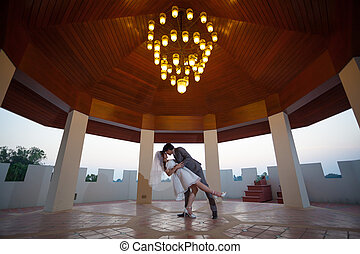 Loving asian couple indoor - Loving asian couple with flower...