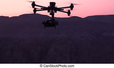 Unmanned Spy - Powerful quadrocopter curled over the canyon...