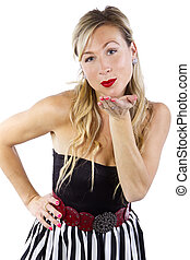 Blowing A Kiss - blond caucasian female blowing a kiss with...